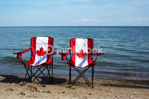 Chairs With Canadian Flag By The Lake Stock Photo Thinkstock