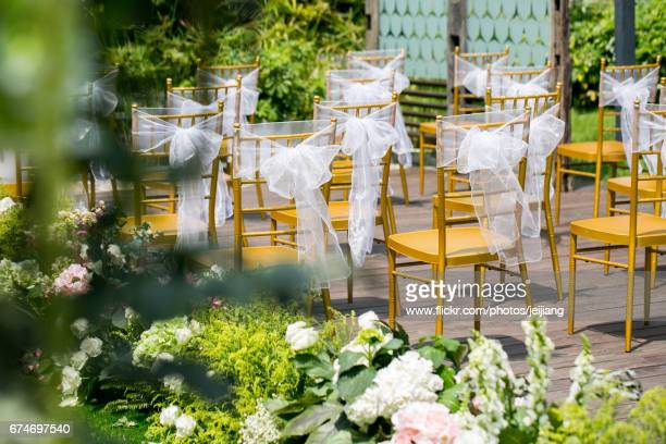 Chairs with decoration beside flower aisle