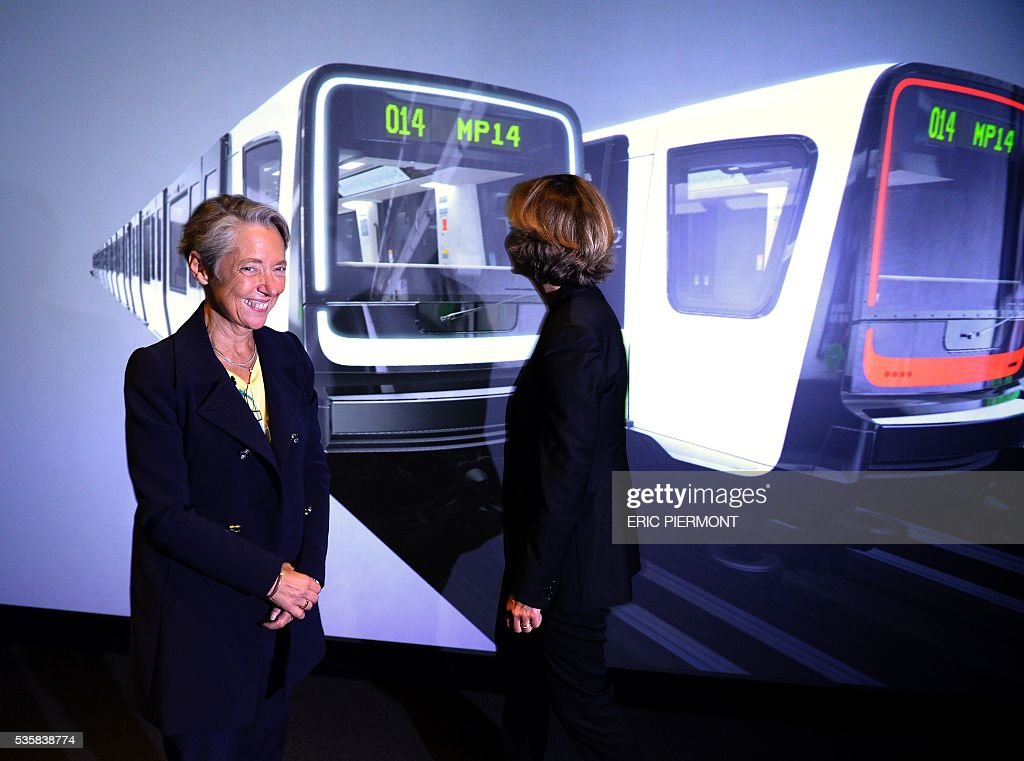 Chairwoman and CEO of French RATP public transport operator Elisabeth Borne (L) and President of the Ile-de-France Region Valerie Pecresse attend the presentation of the design of the future MP14 metro at French transport giant Alstom headquarters in Saint-Ouen on May 30, 2016. / AFP / ERIC