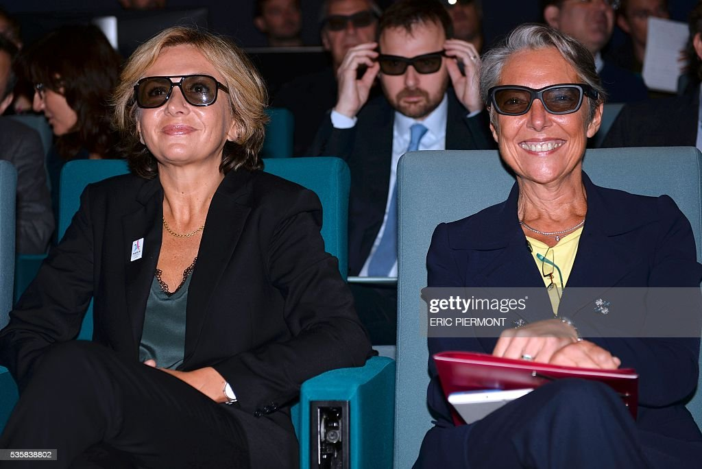 Chairwoman and CEO of French RATP public transport operator Elisabeth Borne (R) and President of the Ile-de-France Region Valerie Pecresse (L) attend the 3D presentation of the future metro MP14 at French transport giant Alstom headquarters in Saint-Ouen on May 30, 2016. / AFP / ERIC