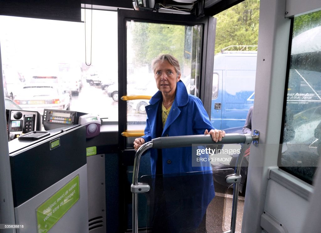 Chairwoman and CEO of French RATP public transport operator Elisabeth Borne boards a bus after attending the presentation of the future MP14 metro at French transport giant Alstom headquarters in Saint-Ouen on May 30, 2016. / AFP / ERIC