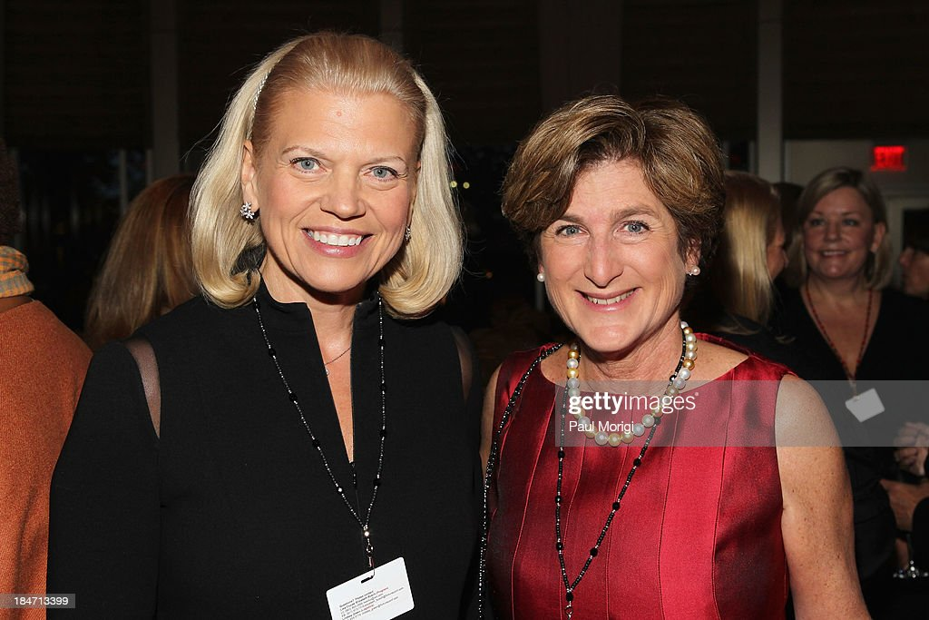 Chairwoman and CEO of IBM Ginni Rometty (L) attends the opening reception during FORTUNE Most Powerful Women Summit on October 15, 2013 in Washington, DC.