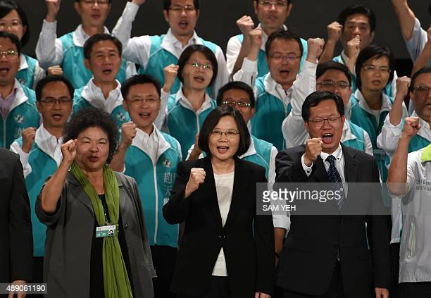 Chairwoman of Taiwan's main opposition Democratic Progressive Party Tsai Ingwen chants slogans with party members during the party congress in...