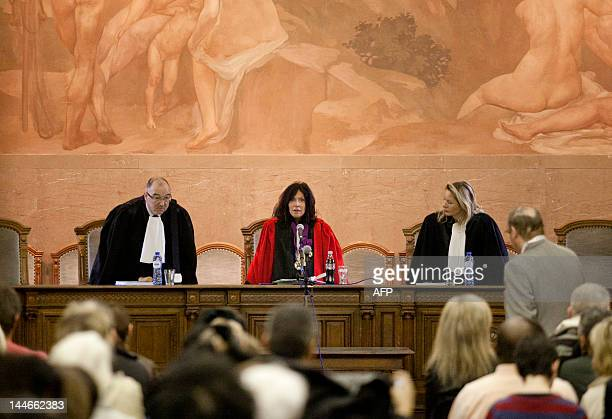 Chairwoman of the court Karin Gerard takes her seat flanked by two magistrates at the start of the trial of Mourad Mazouj Xavier Meert Jamila Zian...