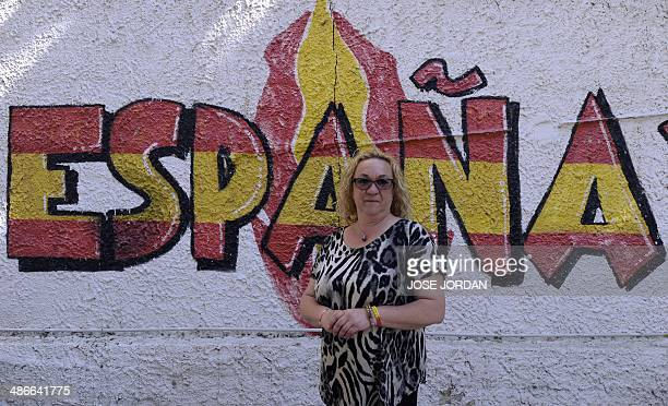 Chairwoman of the NGO Patriotic Social Welfare House Maria Luisa Navarro Azucena Pelayo Sanz poses in front of a mural reading 'Espana 2000' in...