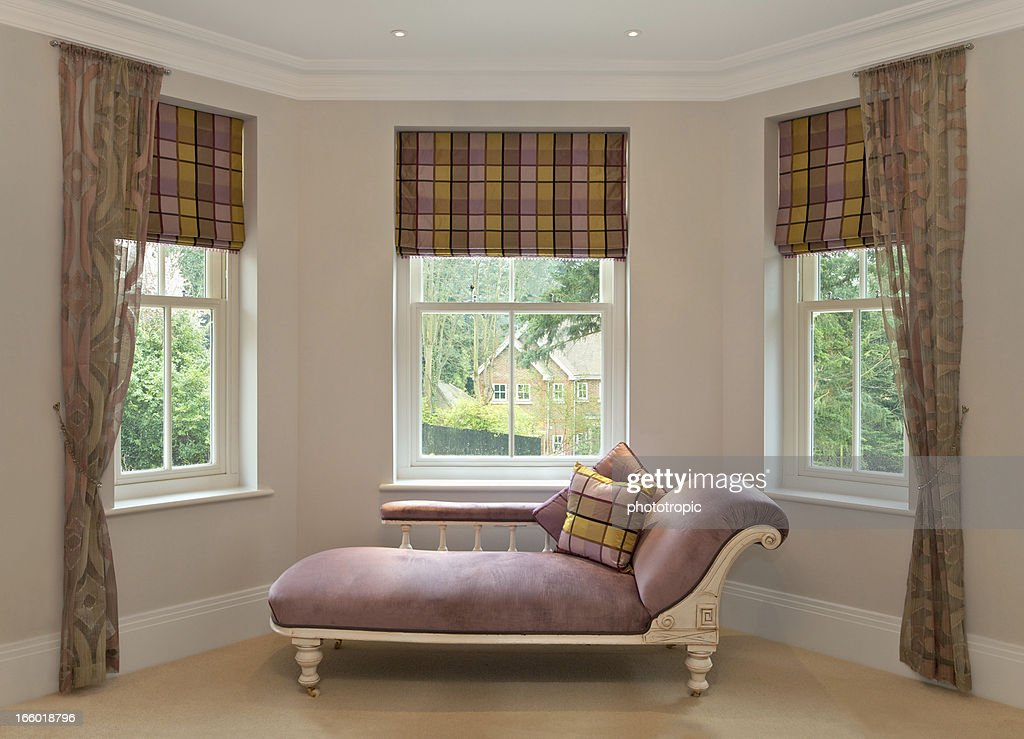 Chaise longue in bay window stock photo getty images for Chaise longue window seat