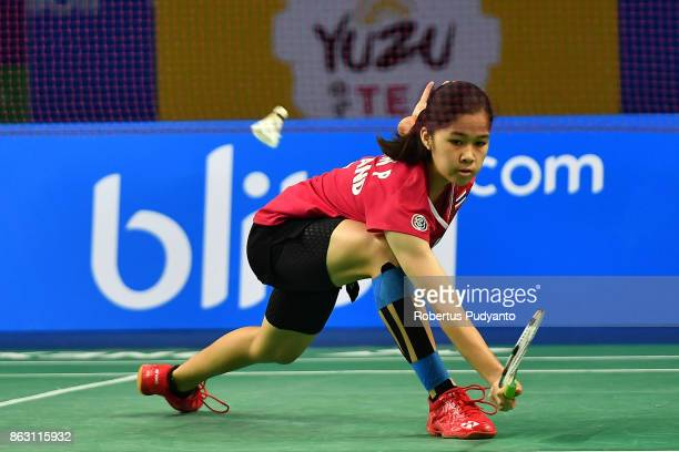 Chaiwan Pattarasuda of Thailand competes against Eoon Qi Xuan of Malaysia during Women's Singles Round 16 match of the BWF World Junior Championships...