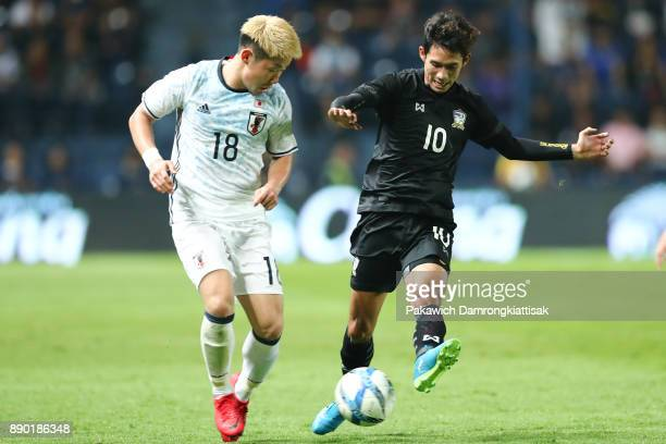 Chaiyawat Buran of Thailand U23 competes for the ball with Suga Daiki of Japan U20 during the M150 Cup 2017 between Thailand U23 and Japan U20 at...