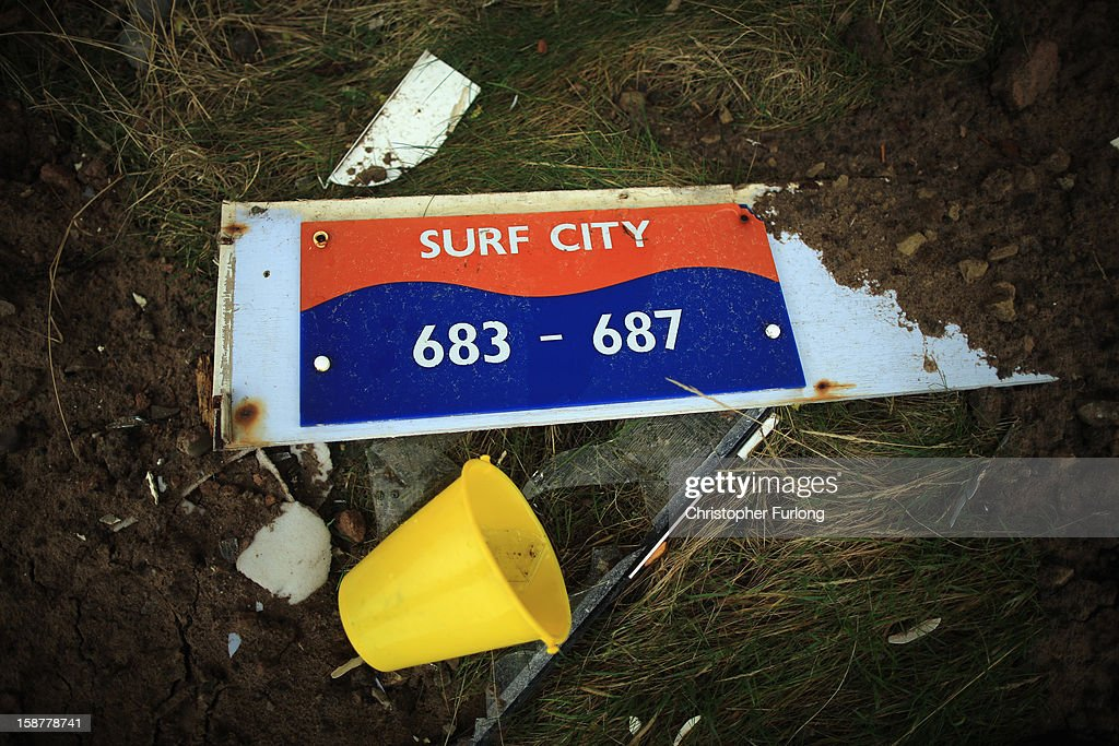 A chalet sign and discarded beach bucket sit outside derelict holiday chalets as they await demolition at Pontins Holiday Camp on December 28, 2012 in Blackpool, England. The Pontin's holiday park in Blackpool is scheduled for demolition after closing in 2009 due to falling visitor numbers, with the land being earmarked for a housing project. The Pontin's British holiday business was originally founded in 1946 by Fred Pontin, providing chalet style holiday accommodation and on site entertainment to visitors. Millions of Britons visited Pontins in it's heyday, being entertained by its famous Blue Coat hosts.