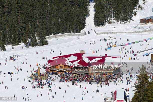 Chalet with tourists in Bansko ski resort, Bulgaria