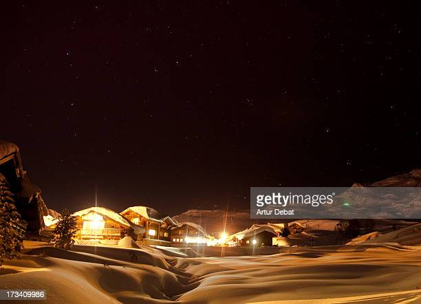 Chalets in snowy landscape in the Alps.