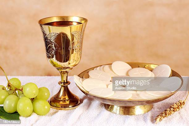 Chalice of wine and a platter with the Communion