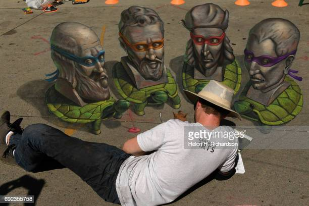 Chalk artist Chris Carlson created a 3D piece he called Old Masters Ninja Turtles that represented the artist masters of the Renaissance during the...