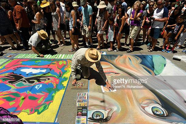 Chalk artist Karl Horeis works on his piece inspired by the dutch artist Johanna Martine during the 14th annual chalk art festival on June 5 2016 in...
