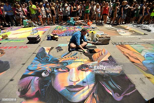 Chalk artist Micha Hollenbeck workes on his piece entitled Chronicles during the 14th annual chalk art festival on June 5 2016 in Denver Colorado The...