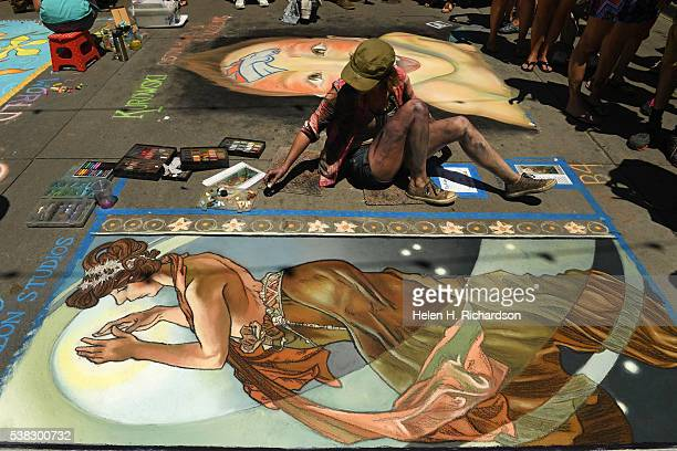 Chalk artist Olivia McLeod works on her piece entitled Pole Star inspired by the 1939 piece created by Czech artist Alphonse Mucha during the 14th...