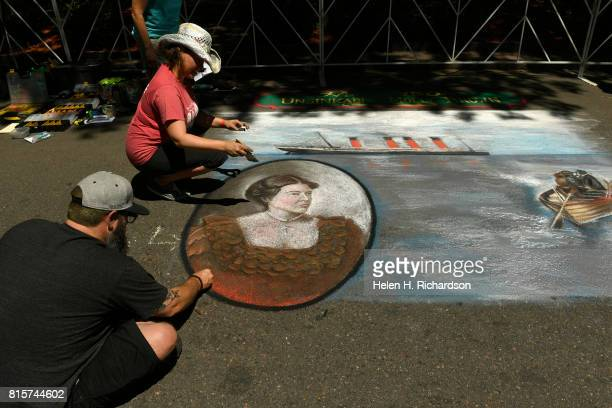 Chalk artists David Osborn left and Jennifer Mosquera in cowboy hat put the finishing touches on a chalk art piece of Molly Brown during the Margaret...