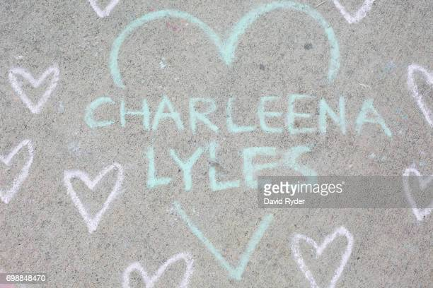 Chalk artwork is written on the ground at a memorial for Charleena Lyles at the apartment building in which she was killed on June 20 2017 in Seattle...