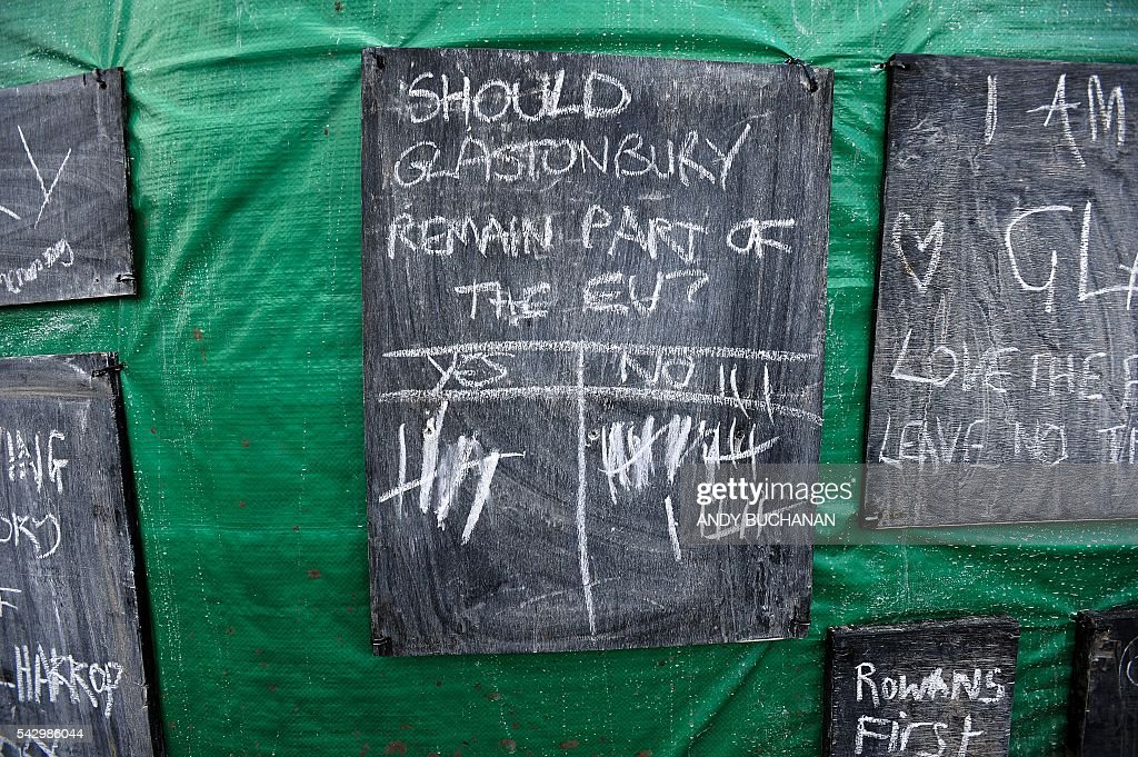 A chalk board is pictured where someone has written the question 'Should Glastonbury remain part of the EU?' on day four of the Glastonbury Festival of Music and Performing Arts on Worthy Farm near the village of Pilton in Somerset, South West England on June 25, 2016. / AFP / Andy Buchanan