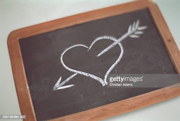 Chalk drawing of heart through arrow