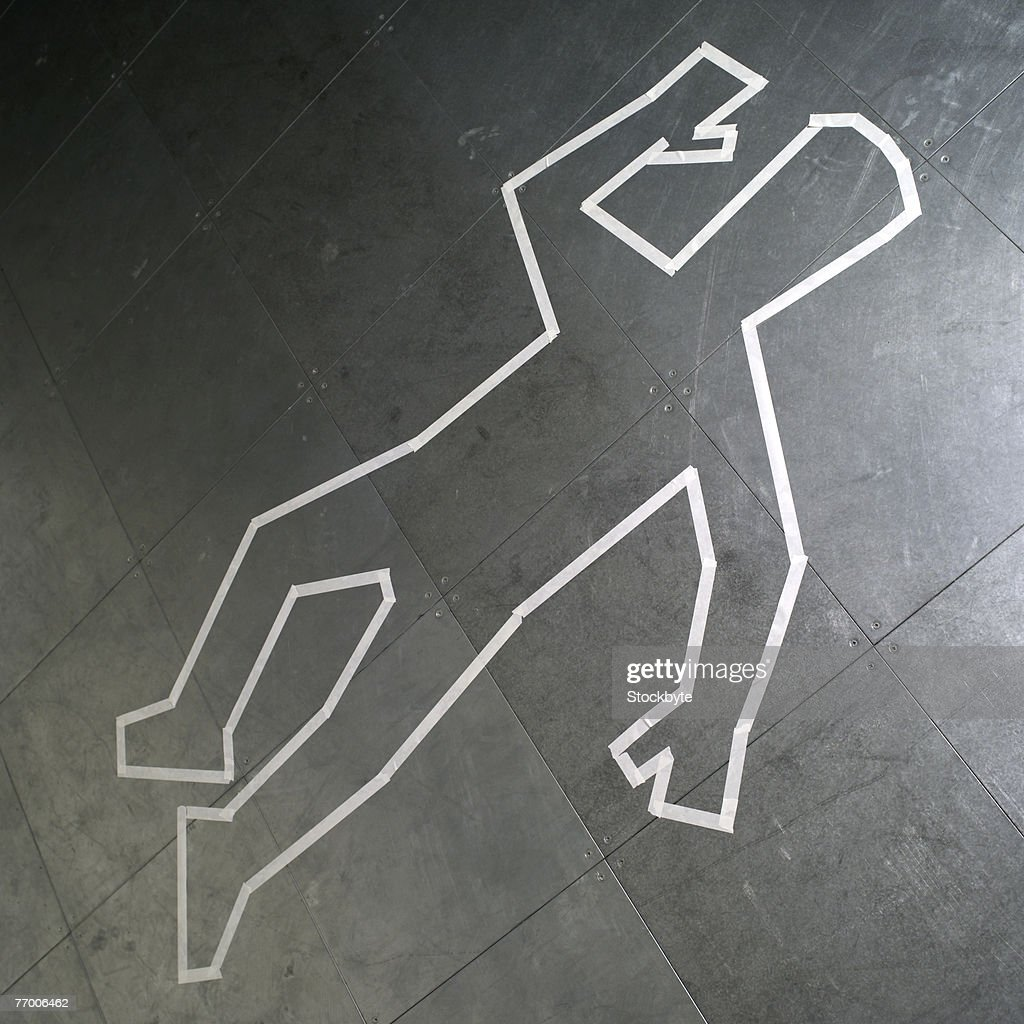 Chalk outline of dead body on pavement : Stock Photo