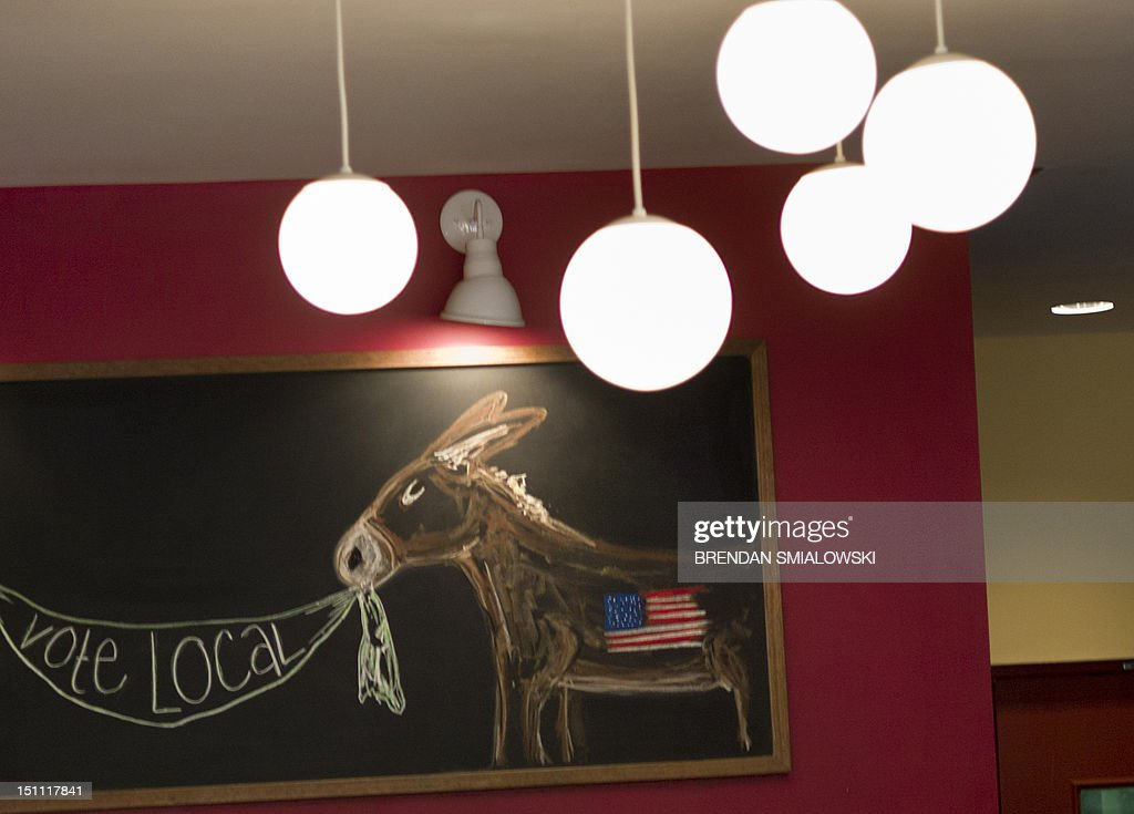 A chalkboard at the Harvest Moon Grille shows a the Democrat's symbol of a donkey on September 1 2012 in Charlotte North Carolina Preparations for...