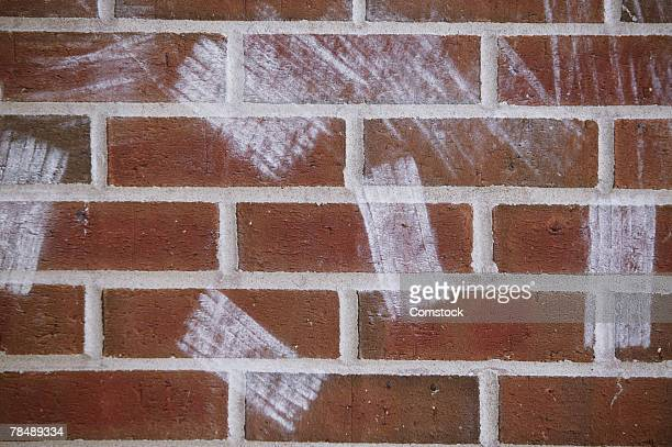 Chalkboard eraser marks on brick wall