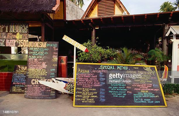 Chalkboard menus outside restaurants.