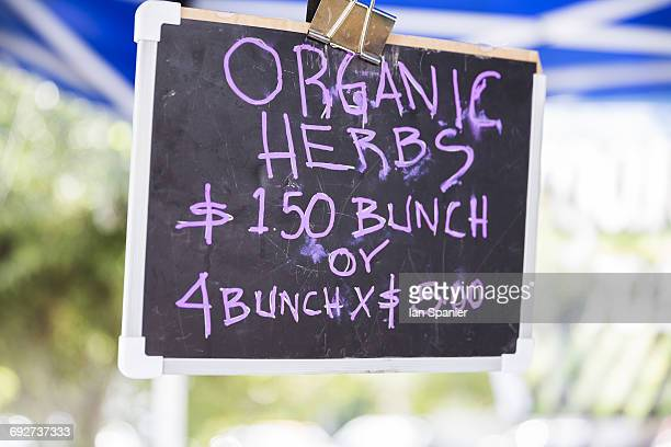 Chalkboard sign at organic fruit and vegetable stall