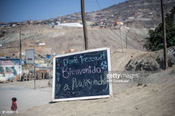 A chalkboard with a welcoming inscription is pictured in San Pablo Mirador community Chancay district in the outskirts of Lima as French world...