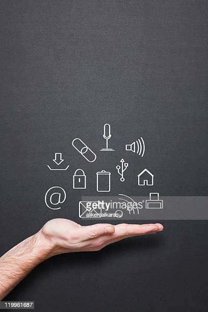 chalkboard with hand and computer related drawing