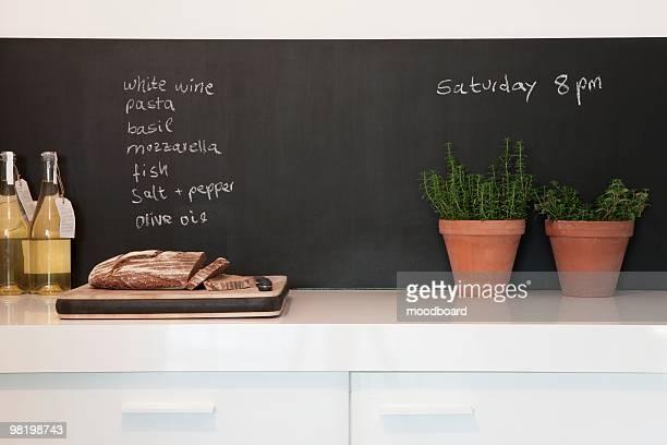 Chalkboard with kitchen herbs