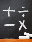 A chalkboard with mathematic symbols on it