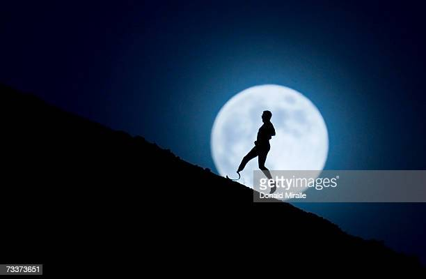 Challenged athlete JP Theberge runs on a trail under moonlight while training for the Carlsbad Marathon on December 3 2006 in San Marcos California...
