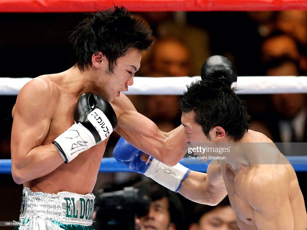 Challenger Akira Yaegashi (R) and champion Toshiyuki Igarashi of Japan compete in the 3rd round during the WBC Flyweight title bout at Ryogoku Kokugikan on April 8, 2013 in Tokyo, Japan.
