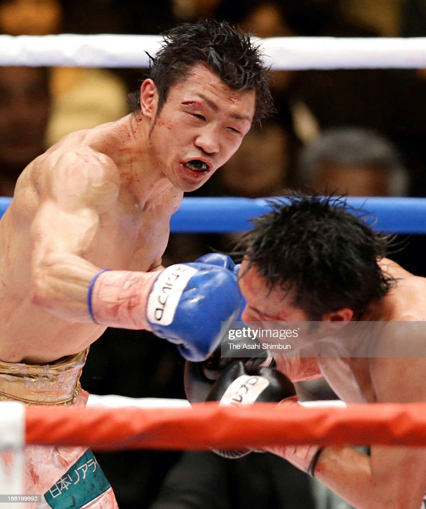 Challenger Akira Yaegashi (L) hits his right on champion Toshiyuki Igarashi of Japan in the 10th round during the WBC Flyweight title bout at Ryogoku Kokugikan on April 8, 2013 in Tokyo, Japan.