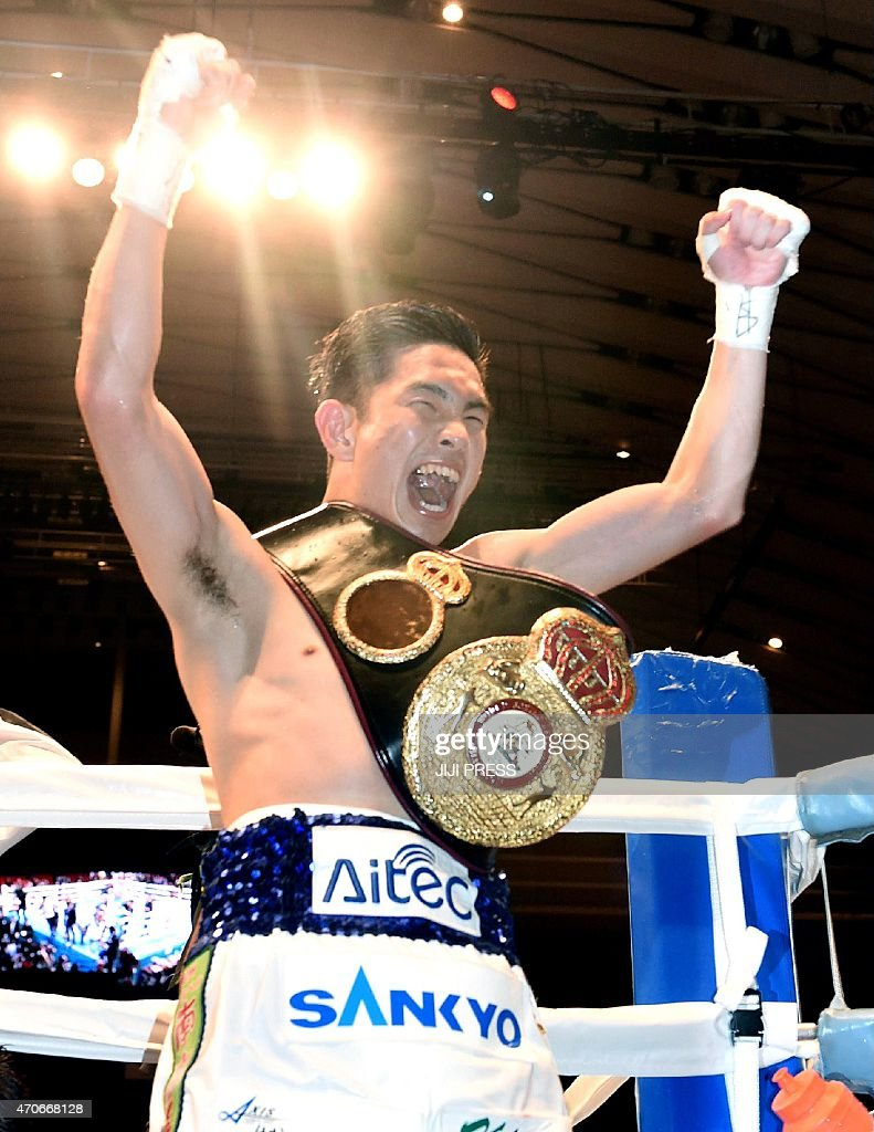 Challenger <a gi-track='captionPersonalityLinkClicked' href=/galleries/search?phrase=Kazuto+Ioka&family=editorial&specificpeople=7488576 ng-click='$event.stopPropagation()'>Kazuto Ioka</a> of Japan gestures after his victory against Juan Carlos Reveco of Argentina during their WBA flyweight title boxing bout in Osaka on April 22, 2015. Ioka clinched the belt by decision 2-0.