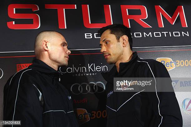 Challenger Martin Murray of Great Britain and WBA middleweight champion Felix Sturm pose during a press conference at Holiday Inn Hotel on November...