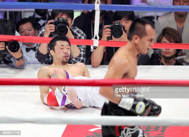 Challenger Milan Melindo of the Philippines knocks down champion Akira Yaegashi of Japan in the first round during their IBF Light Flyweight Title...