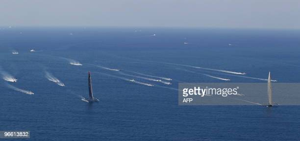 US challenger Oracle giant trimaran sails ahead of Swiss defender Alinghi huge catamaran during the opening race of the 33rd America's Cup off...
