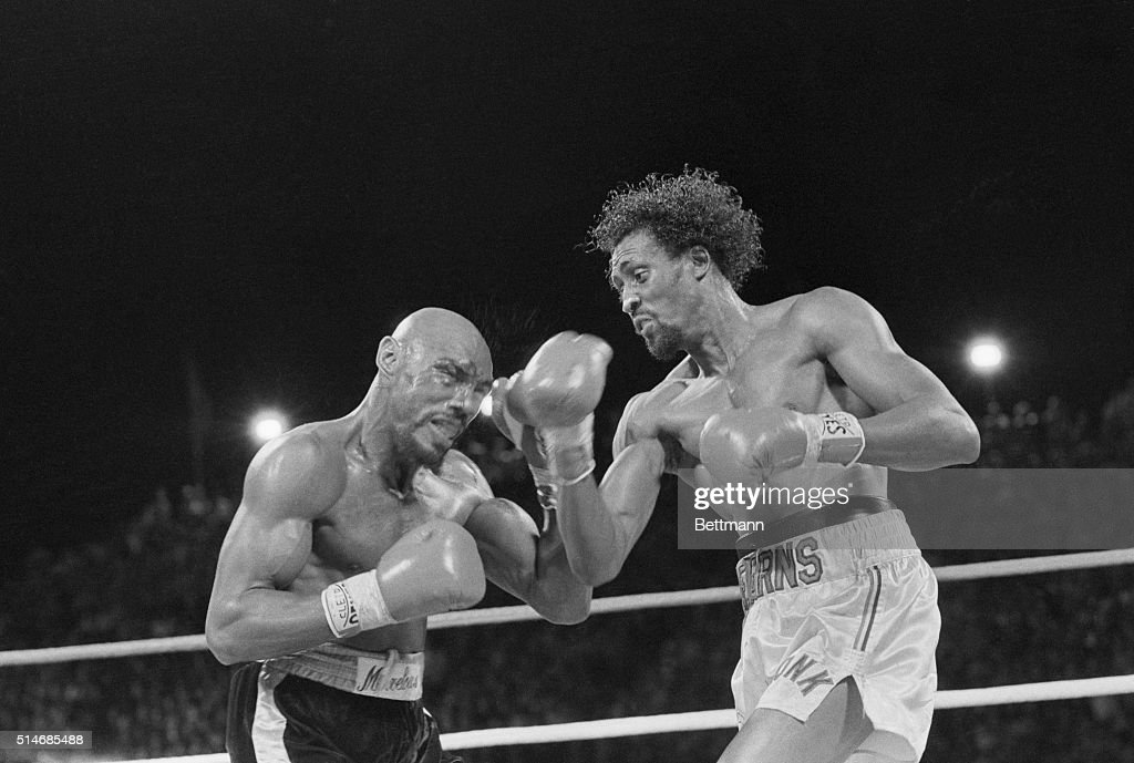 Challenger Thomas 'Hit Man' Hearns strikes middleweight champion 'Marvelous' Marvin Hagler with a right to the face during a boxing match in Las...