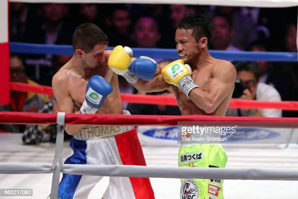 Challenger Thomas Masson of France and champion Daigo Higa of Japan exchange punches in the 5th round during their WBC Flyweight Title Bout at...