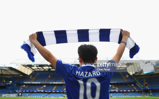 A challenges fan holds up a scarf prior to the Premier League match between Chelsea and Swansea City at Stamford Bridge on February 25 2017 in London...