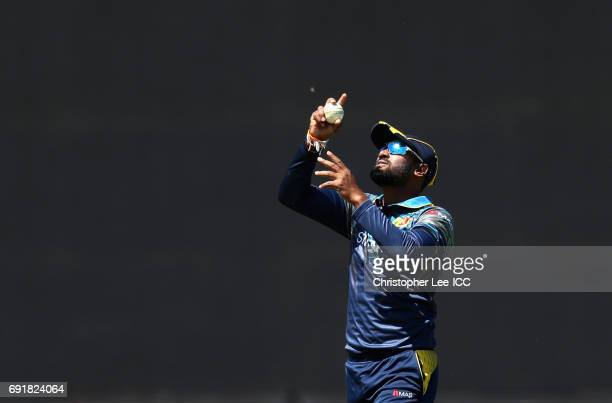 Chamara Kapugedara of Sri Lanka points to the sky after he takes the wicket of AB De Villiers of South Africa during the ICC Champions Trophy Group B...