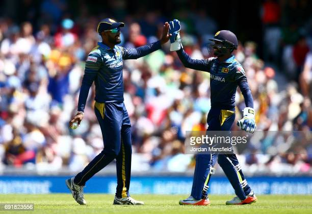 Chamara Kapugedera and Niroshan Dickwella of Sri Lanka celebrate dismissing AB de Villiers of South Africa during the ICC Champions Trophy match...