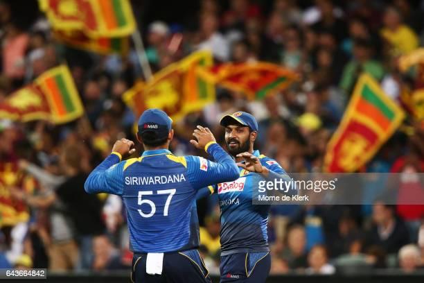 Chamara Kapugedera of Sri Lanka celebrates after taking a catch to get the wicket of Travis Head of Australia during the International Twenty20 match...
