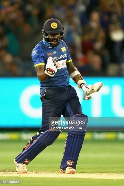 Chamara Kapugedera of Sri Lanka celebrates hitting the winning run during the first International Twenty20 match between Australia and Sri Lanka at...