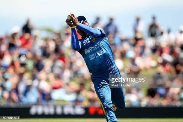 Chamara Kapugedera of Sri Lanka holds a catch to dismiss Luke Ronchi of New Zealand during the third One Day International match between New Zealand...
