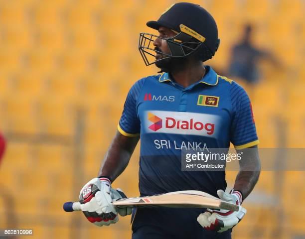 Chamara Kapugedera of Sri Lanka leaves the field during the third one day international match between Pakistan and Sri Lanka in Abu Dhabi at Zayed...