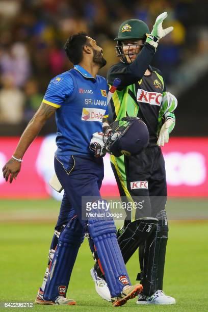 Chamara Kapugedera reacts to Tim Paine of Australia after hitting the winning runs during the first International Twenty20 match between Australia...